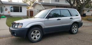 2005 subaru forester with winter tires on rims