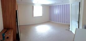 Double room with en suite to rent in large town centre flat - sharing with two professional females