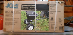 Tow behind spreader-brand new in box