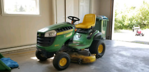 John Deere D140 with Attachments