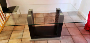 Black wooden framed glass top table