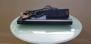 Sony DVD player with AV cables and remote - $10
