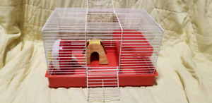 Small hamster cage with accessories.