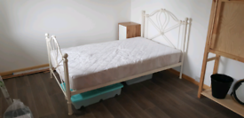 Queen size bed with mattress and cover