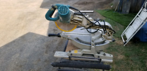 Makita compound mitre saw with folding stand.