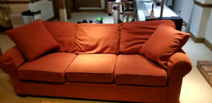 Red sofa with matching single seat and ottoman