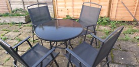 4 chairs and glass garden table