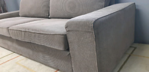 Ike brown Couch/delivery available
