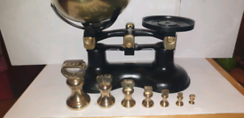 Old victor of England scales with weights