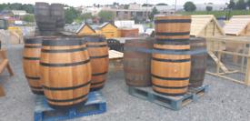 Full Oak barrels and half barrel planters painted and varnished