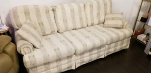 A sofa, loveseat and a recliner
