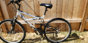 mid frame suspension mountain bike with lockout bar