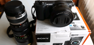 New Sony a5100 + box,  battery, charger, extra telephoto lens