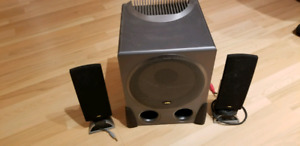 Two speakers and a subwoofer CA brand