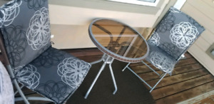 Lovely smoked glass bistro table,  chairs and near new cushions