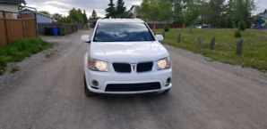 2008 White Pontiac Torrent