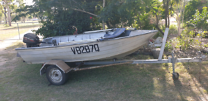 Boat tinny with motor trailer and accessories