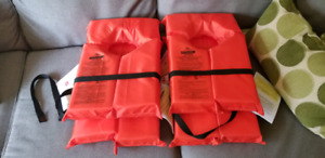 Four Stearns Adult universal PFD Lifejacket