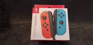 BRAND NEW Red and Blue Joycons Switch NEUF