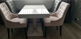White gloss table and four chairs