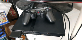 PS2 Slim, controller, memory card, 18 games, no sports titles.