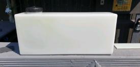Auto top up storage tub