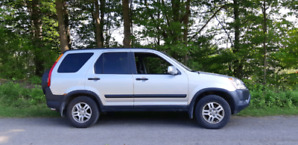 Honda crv 2003 good engine need Body Repair 3000$ .. As is