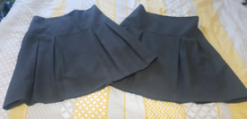 Like new 2 pack grey school skirts age 13-14 years