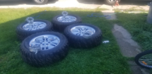 """20"""" Chevy tires & rims + spacers"""