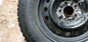 4 WINTER RIMS AND 215/70R/16  TIRES GREAT SHAPE