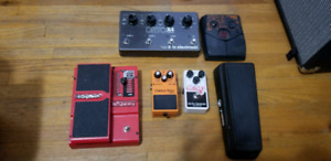 Assorted Guitar Pedals, Power Sources, and Patch Cables.  See de