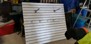 Slotted wall board with few hangers