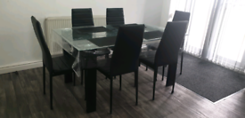 Glass Dining Table and 6 Faux Leather Chairs
