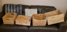 Large assortment of rattan storage baskets