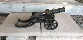 Cast iron cannon and Garden ornaments