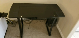 Computer desk with black tempered glass