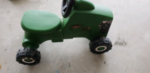 Small kids ride on tractor