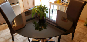 ELEGANT BLACK TABLE AND CHAIRS