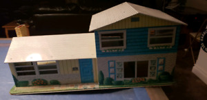 Vintage metal tin doll house and garages only 50 dollars
