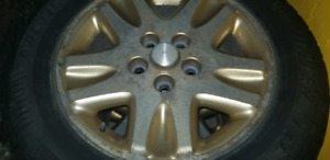 225/60 R16 studded Winter Tires with alloy wheels