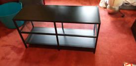 Black Ikea TV stand. Metal and glass.