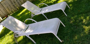 2 light pink lounge chairs
