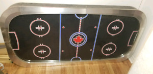 Air hockey table top.
