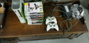 Xbox 360  17 games 2 controllers 2 headsets.