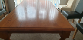 Solid Wood Dinning Table holds six Chairs