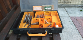 Box of assorted taps and bits and bobs