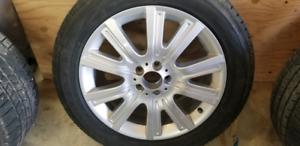 Mercedes ML350 factory OEM rims and winter tires.