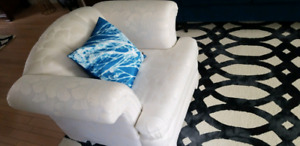 Mint condition couch and chair set rarely sat on
