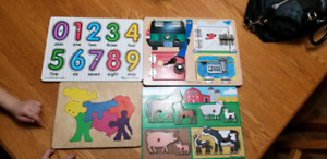 4 woodwn puzzles