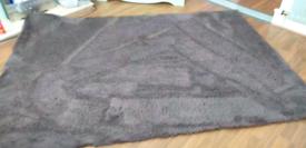 Large, greyish rug.